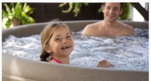 Father and Young Daughter Hot Tubbing